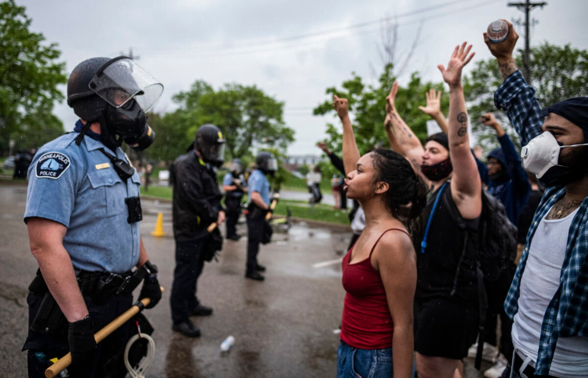 Protesters and police face each other during a rally for George Floyd in Minneapolis on Tuesday, May 26, 2020. (Richard Tsong-Taatarii/Star Tribune via AP)