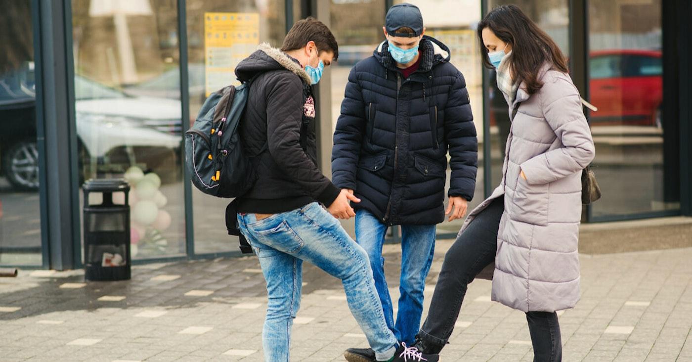 People touching legs