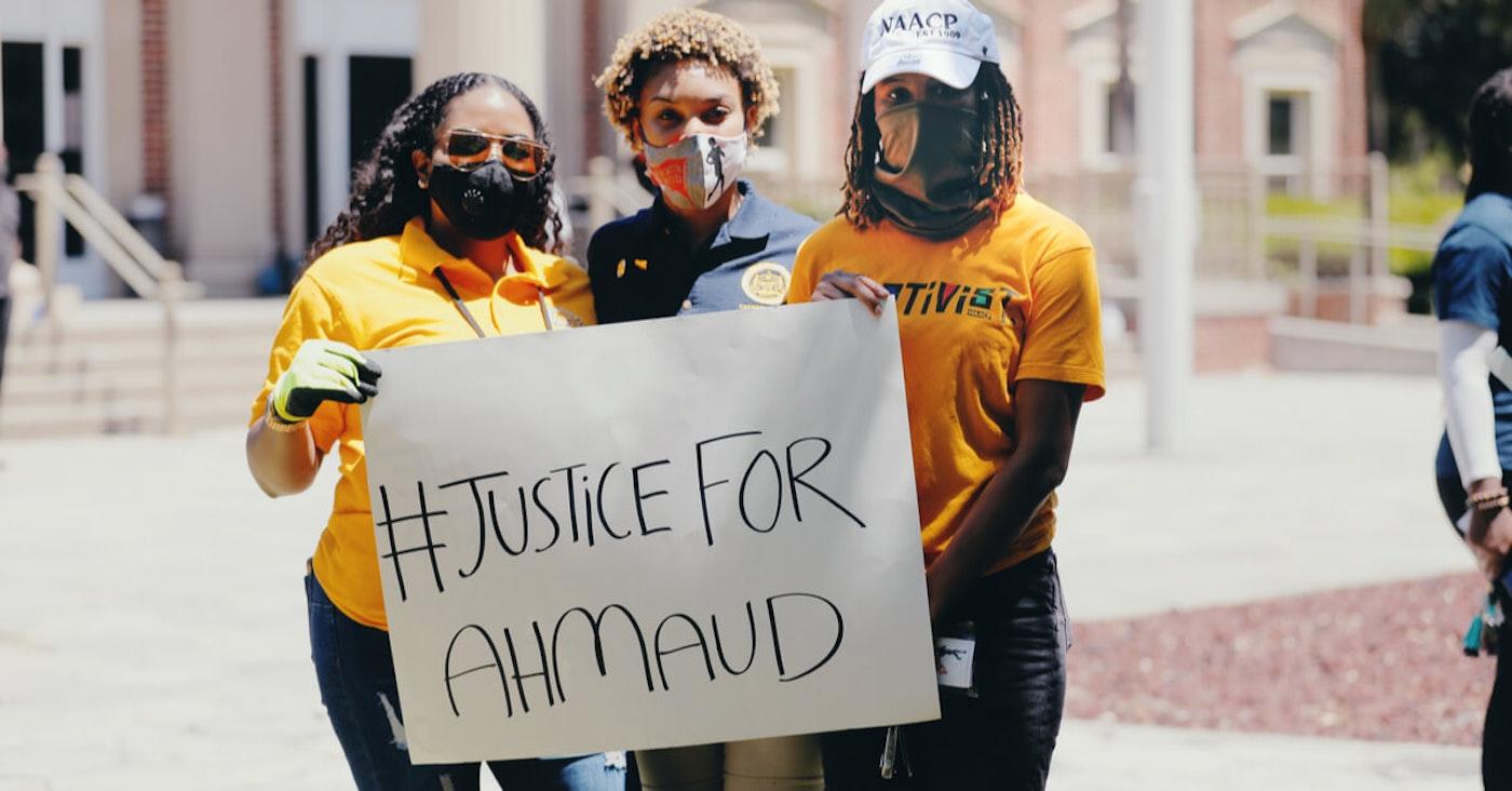 Women protesting Ahmaud's death