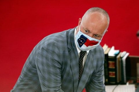 House minority leader Darren Jackson, D-Wake, wears a mask at the legislature April 28. (AP Photo/Gerry Broome)