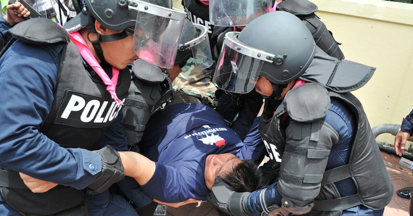 Police manhandling a protester