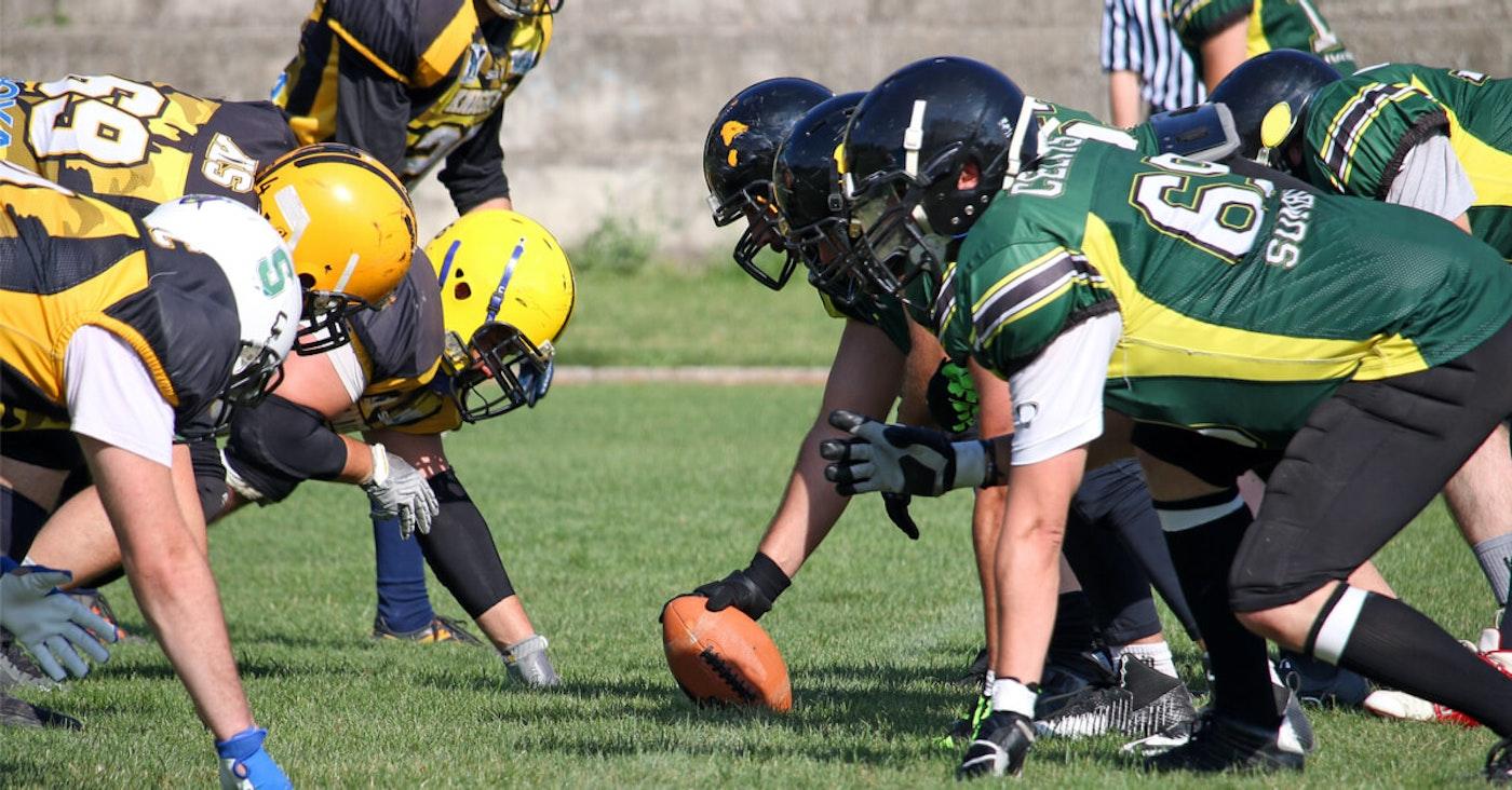 Students-playing-football