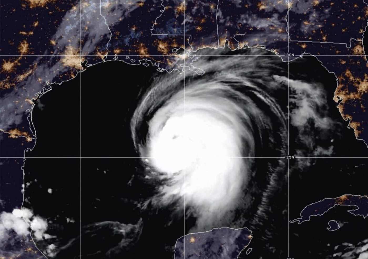 """This satellite image released by the National Oceanic and Atmospheric Administration (NOAA) shows Hurricane Laura churning in the Gulf of Mexico, Wednesday, Aug. 26, 2020. Forecasters say Laura is rapidly intensifying and will become a """"catastrophic"""" Category 4 hurricane before landfall. (NOAA via AP)"""