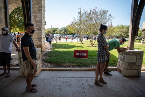 Voters wait in line at a polling location in Austin, Texas. Photo by Sergio Flores/Getty Images.