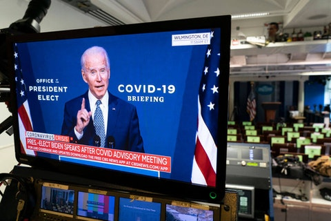 President-elect Joe Biden is shown speaking on a monitor about coronavirus disease (COVID-19) in the briefing room of the White House on November 9, 2020 in Washington, DC. U.S. The drug maker Pfizer announced that a coronavirus vaccine trial suggested their vaccine was up to ninety percent effective in preventing Covid-19. (Photo by Joshua Roberts/Getty Images)