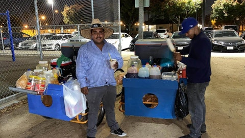 Roberto, a 24-year-old street vendor, said he continues to work because he hasn't been able to find another job.
