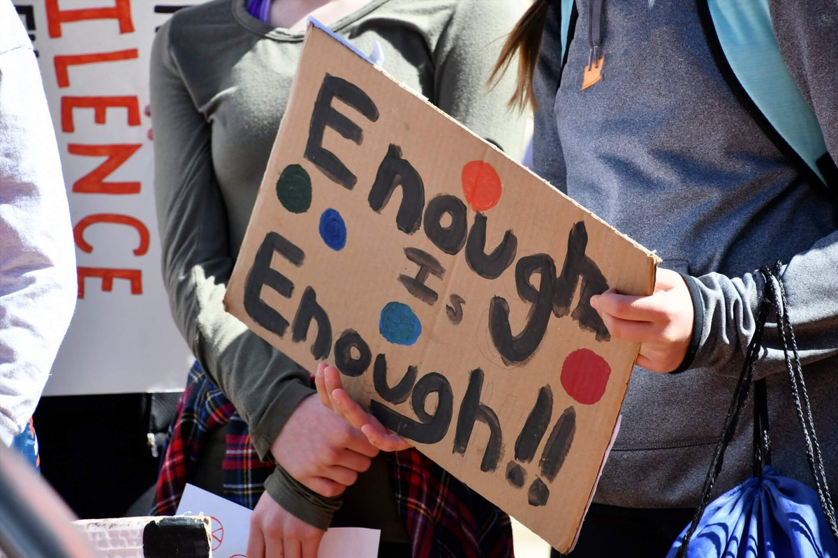 student-protesters-staging-a-walkout-march-due-to-school-shootings-and-gun-violence-real-people-human_t20_ro4EBw