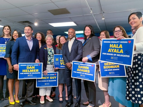 Human Rights Campaign President Alphonso David (center) poses for a photo with Virginia House and Senate candidates during an Aug. 15 press event in Richmond.