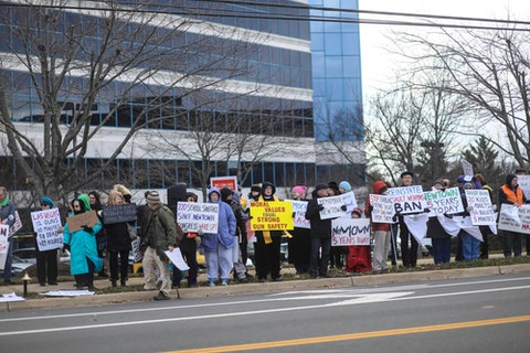Fairfax, VA - December 14, 2017: Protesters gather outside the National Rifle Association for a vigil on the fifth anniversary of the Sandy Hook Elementary School shooting in Newtown, Connecticut. (Shutterstock)