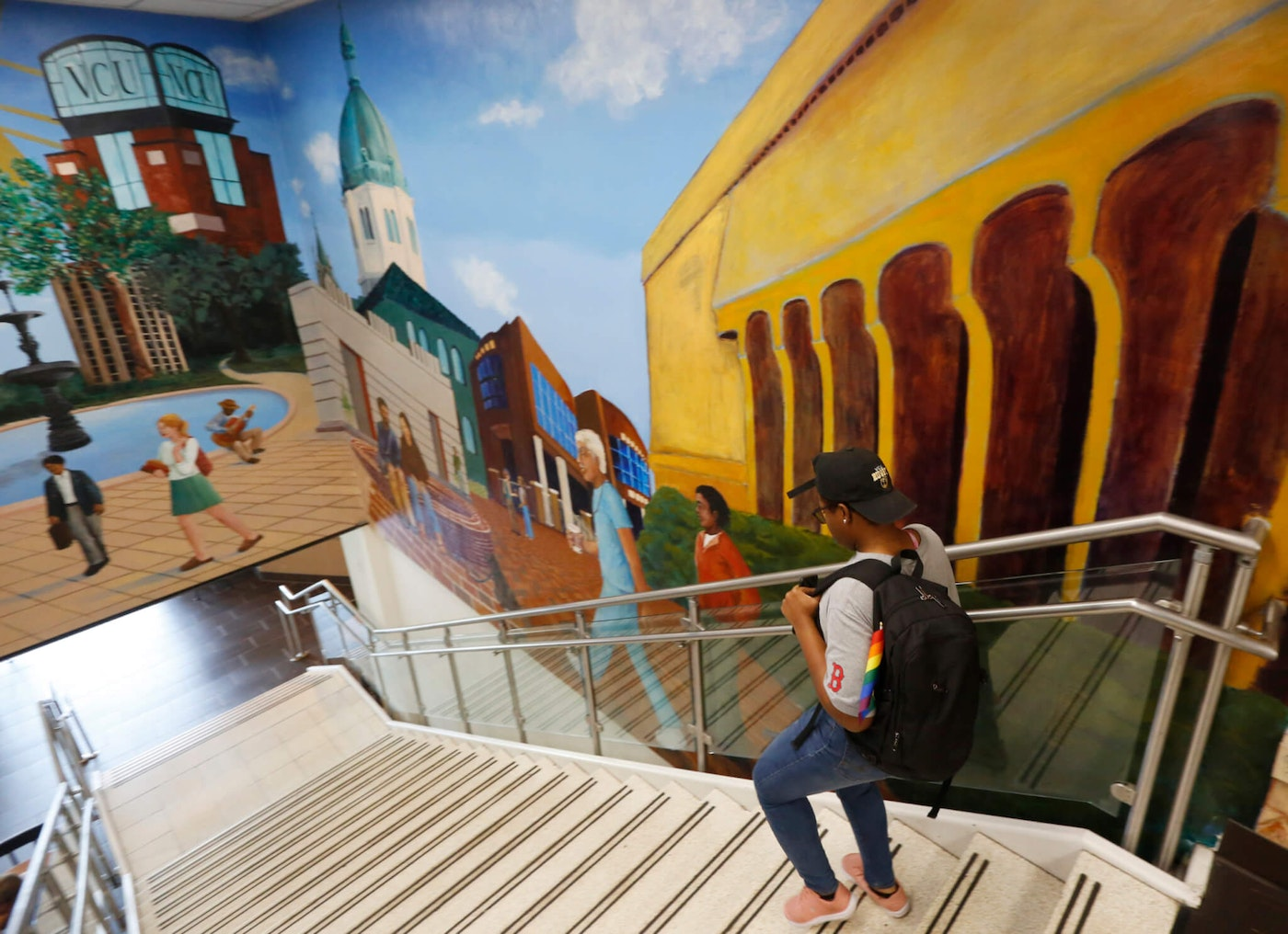 A student walks past a mural in the library at Virginia Commonwealth University in Richmond, Va. (AP Photo/Steve Helber)