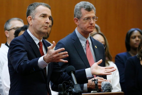 Gov. Ralph Northam, left, speaks, accompanied by state Secretary of Health and Human Resources Dr. Daniel Carey. (AP Photo/Steve Helber)