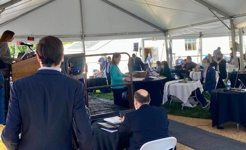 Virginia House of Delegates Speaker Eileen Filler-Corn convenes a session in a tent outside the state capitol building. (Image via Facebook)