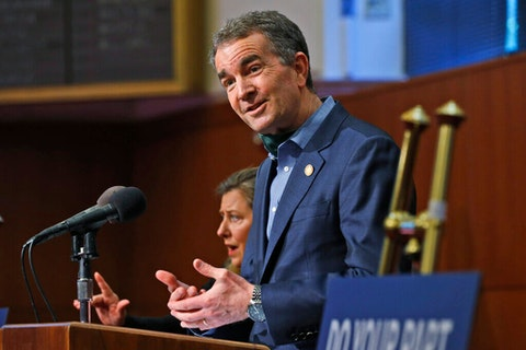 Virginia Gov. Ralph Northam gestures duding a news conference at the Capitol in Richmond, Va.(AP Photo/Steve Helber)