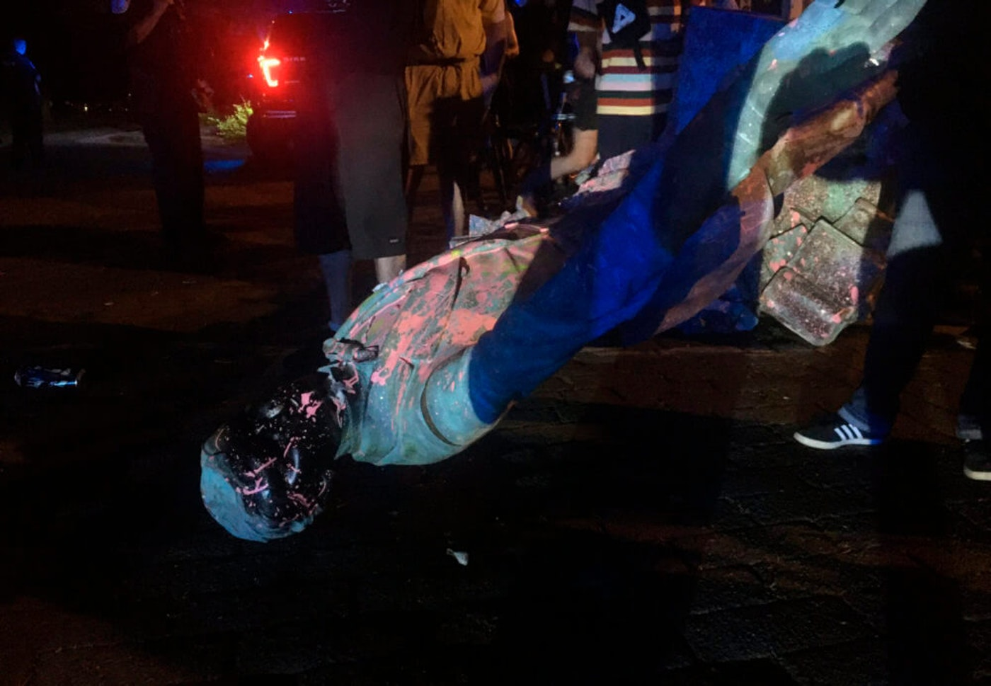 The statue of Confederate President Jefferson Davis is splattered with paint after it was toppled Wednesday night, June 10, 2020, along Monument Drive in Richmond, Va. (Dylan Garner/Richmond Times-Dispatch via AP)
