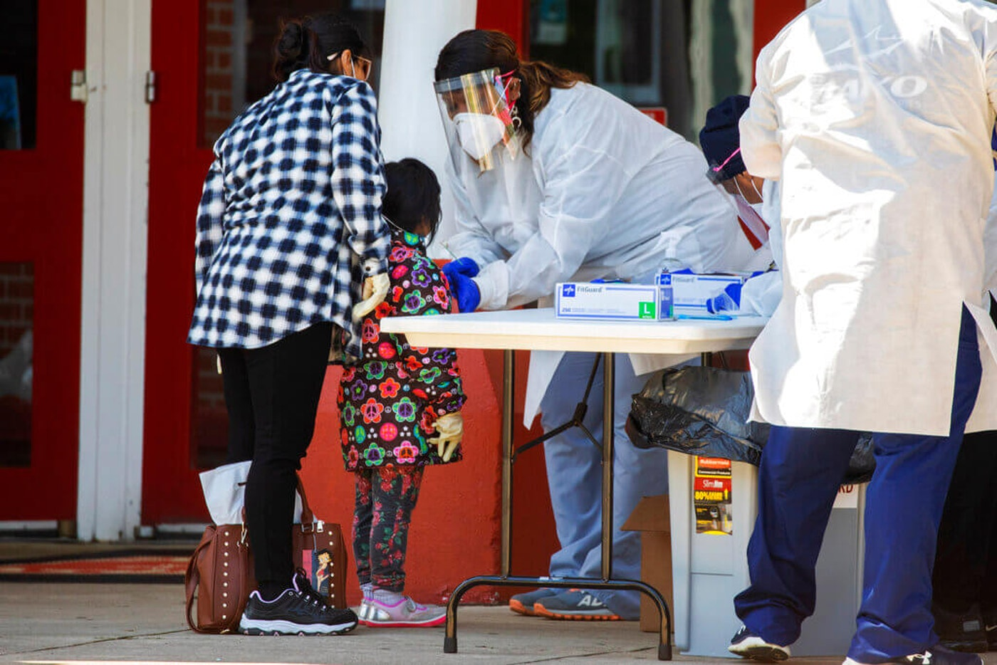 A little girl is tested for COVID-19 at Annandale High School, in Annandale, Va. (AP Photo/Jacquelyn Martin)