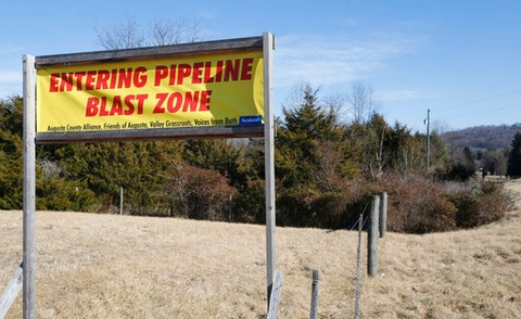 A sign along a highway to protests the route of the Atlantic Coast Pipeline in Deerfield, Va. The developers of the Atlantic Coast Pipeline announced Sunday, July 5, 2020, that they are canceling the multi-state natural gas project, citing delays and increasing cost uncertainty. (AP Photo/Steve Helber, File)
