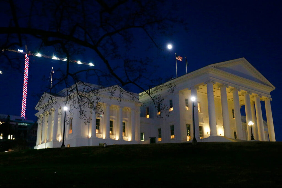 The moon rises over the Virginia state Capitol in Richmond, Va., Wednesday, Jan. 8, 2020. Members of the General Assembly are meeting at nearby Virginia Commonwealth University to give them more space to social distance. (AP Photo/Steve Helber)