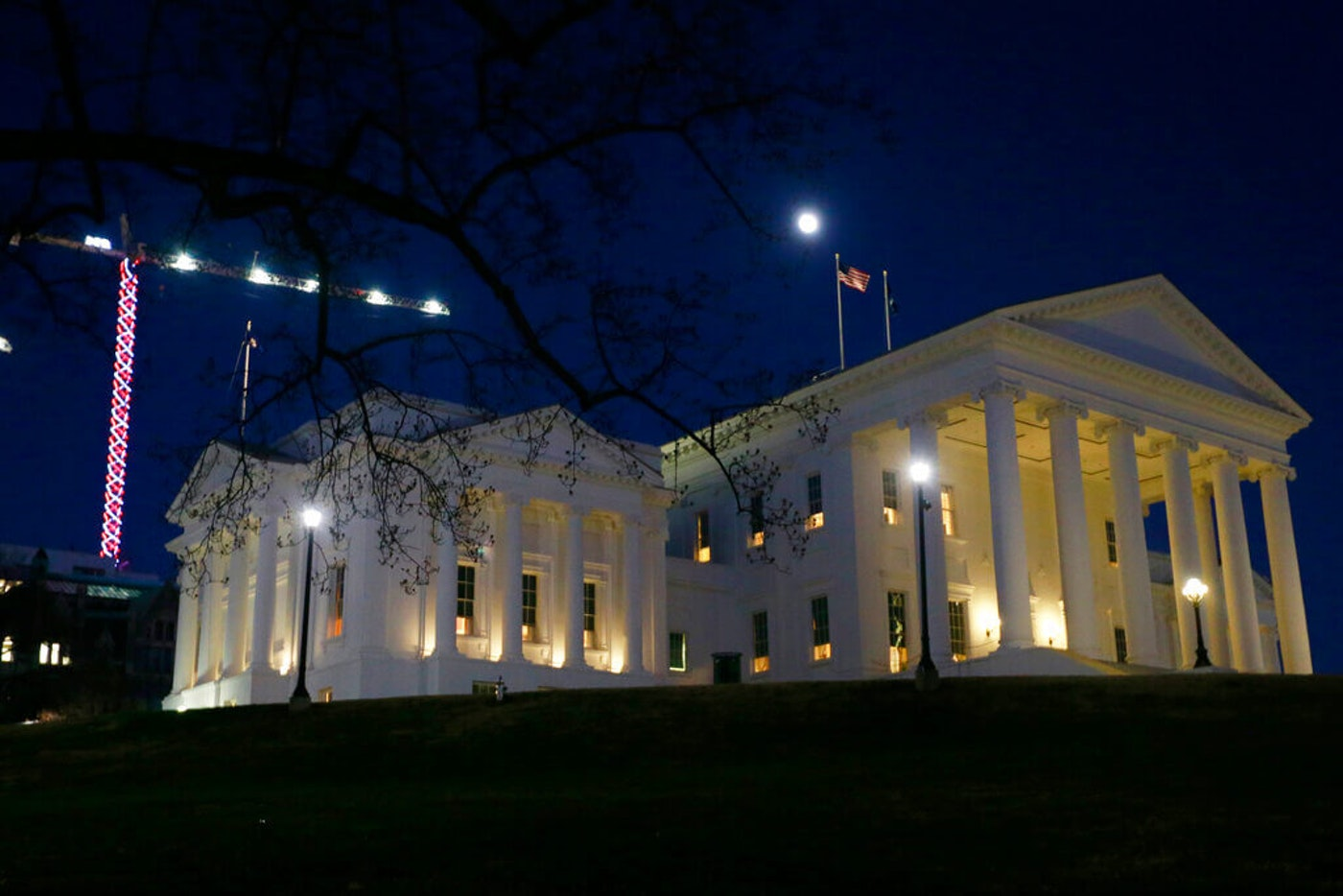 The moon rises over the Virginia state Capitol in Richmond, Va., Wednesday, Jan. 8, 2020. (AP Photo/Steve Helber)