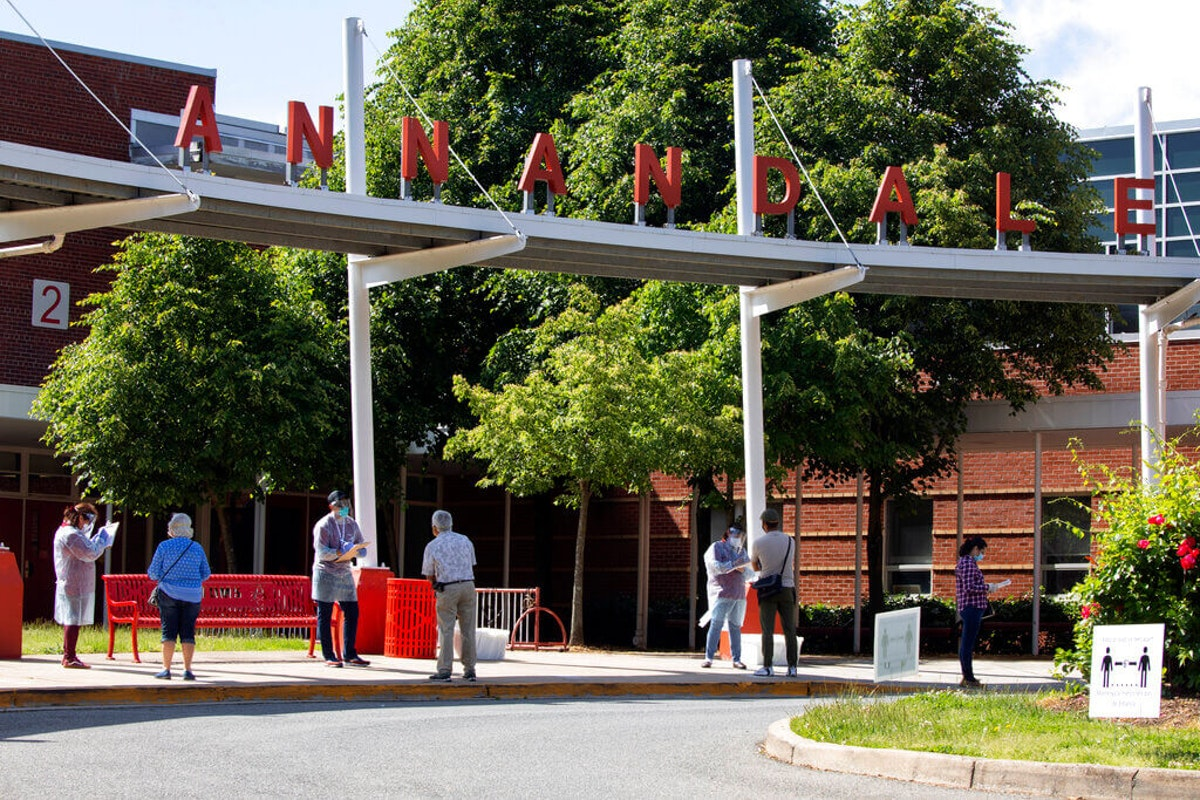 People are registered for COVID-19 testing in a walk up line outside of Annandale High School (AP Photo/Jacquelyn Martin)