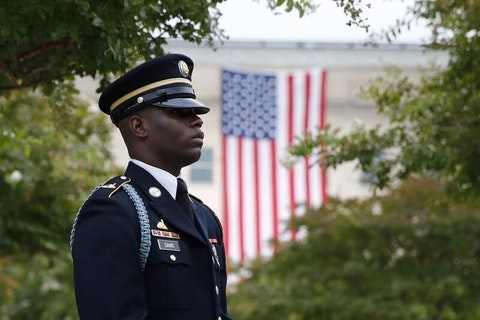 In this Sept. 11, 2019, file photo, a member of the U.S. Army Old Guard stands on the grounds of the National 9/11 Pentagon Memorial before a ceremony in observance of the 18th anniversary of the September 11th attacks at the Pentagon in Washington. On Sept. 11, 2020, Americans will commemorate 9/11 with tributes that have been altered by coronavirus precautions and woven into the presidential campaign. (AP Photo/Patrick Semansky, File)