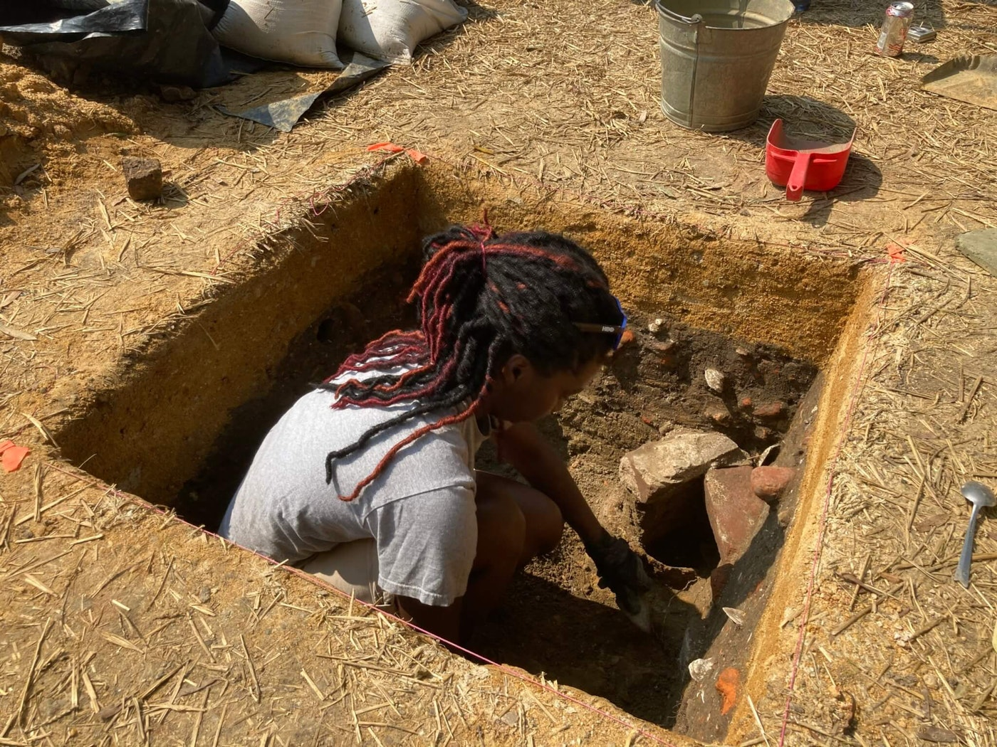 Colonial Williamsburg Archaeological Field Technician DéShondra Dandridge at the excavation site of First Baptist Church's original permanent location on South Nassau Street, Sept. 23, 2020. This year a partnership led by First Baptist Church and Colonial Williamsburg has resumed archaeological investigation of the site, which last took place in 1957.  Photo courtesy of Colonial Williamsburg.