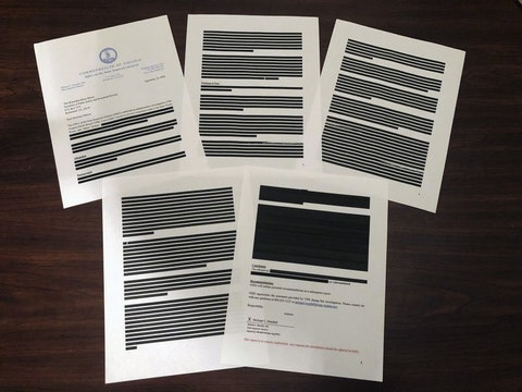 Heavily redacted documents from Virginia's Office of the State Inspector General, addressed to Brian Moran, Democratic Gov. Ralph Northam's secretary of public safety and homeland security, and provided to The Associated Press in response to an open records request are displayed, Tuesday, Oct. 6, 2020, in Richmond, Va. The OSIG has found new problems with victim and prosecutor notification in cases handled by the state parole board, according to other documents provided Tuesday to lawmakers. (AP Photo/Sarah Rankin)