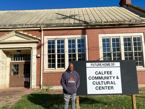 Dr. Mickey Hickman stands in front of the future Calfee Community & Cultural Center. Dogwood photo by Ashley Spinks Dugan.