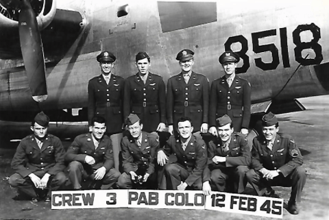 Third from the left on the front row, Houston Smith, Sr. holds the Carl W. Falk Crew's mascot, a black puppy.  Contributed photo.
