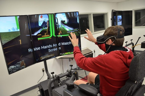 Mitchell Dunford, a Patrick Henry Community College   General Engineering Technology student, tests out a new simulator the college recently purchased. Contributed photo.