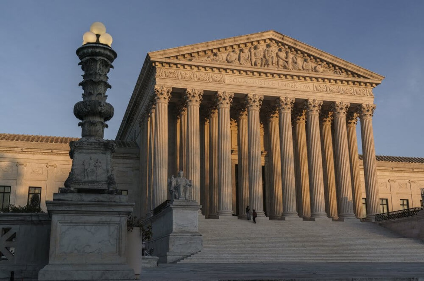 In this Nov. 6, 2020, file photo the Supreme Court is seen as sundown in Washington. The Supreme Court rejected on Dec. 11,a lawsuit backed by President Donald Trump to overturn Joe Biden's election victory, ending a desperate attempt to get legal issues rejected by state and federal judges before the nation's highest court. (AP Photo/J. Scott Applewhite, File)