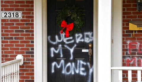 graffiti on McConnell's door saying Where's My Money while Americans wait for stimulus checks