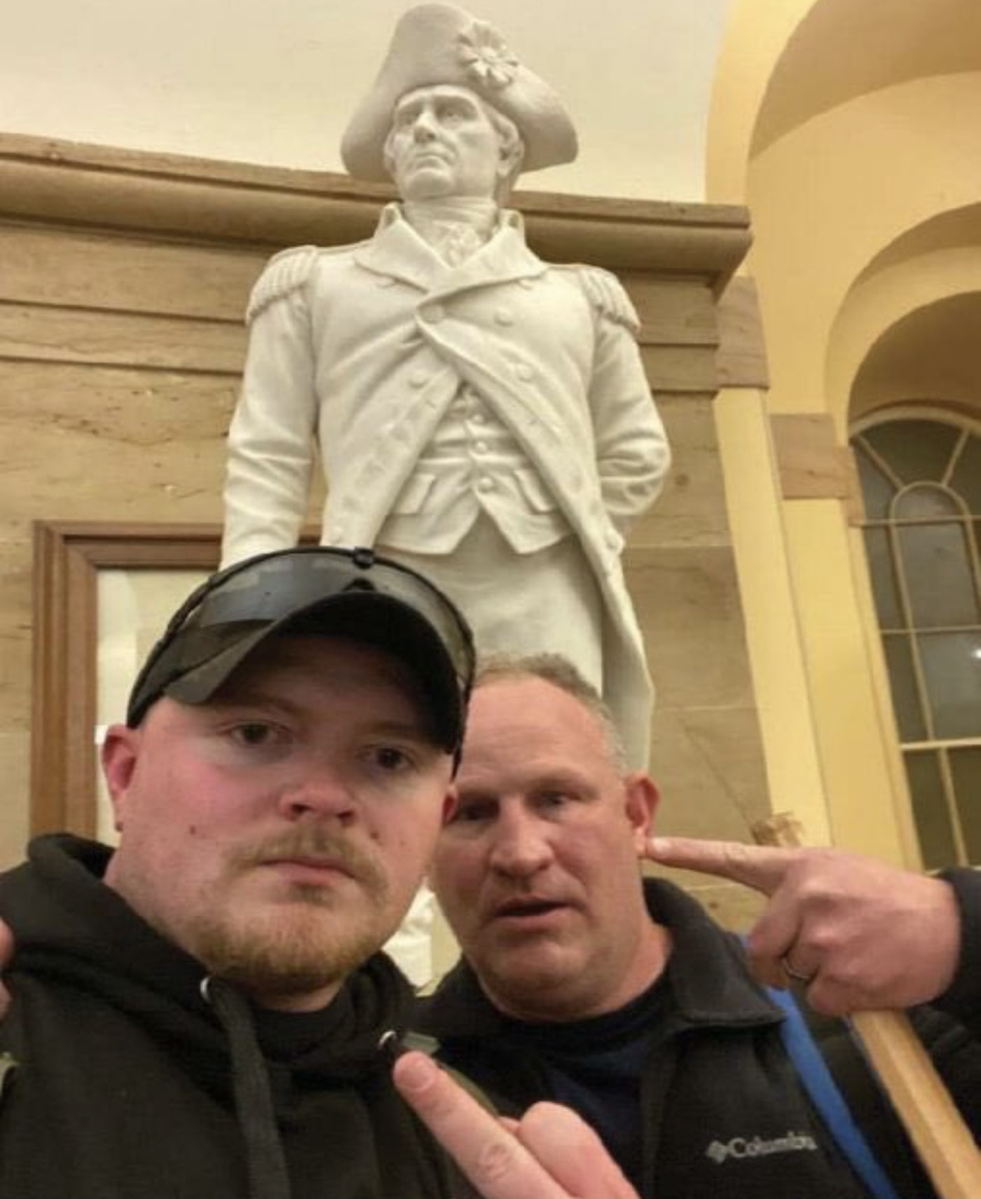 In a photo posted to social media by Robertson, the two men pose in the Capitol Crypt on Jan. 6.