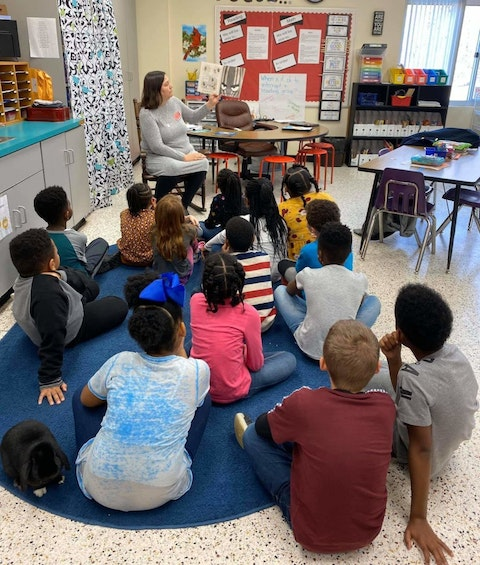 Contributed photo - Jennifer Williams reads to children at a local elementary school.