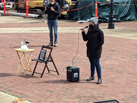 A rally organizer invites attendees to speak about their grievances with VCU administration.