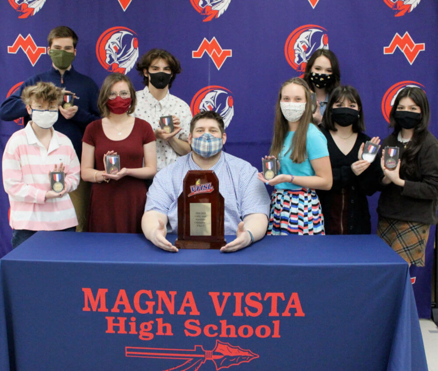Magna Vista High School won first place at the VHSL Forensics State Championships.  Seated: Bryan Dunn, MVHS Forensics coach Standing Row 1 (L to R): Ava Knight, Lauren Trent, Brianna Tatum, Ivanna Gutierrez, Joanna Gutierrez Standing Row 2 (L to R): Brayden Lynch, William Ortega, MacKenzie Morrison. Contributed photo.