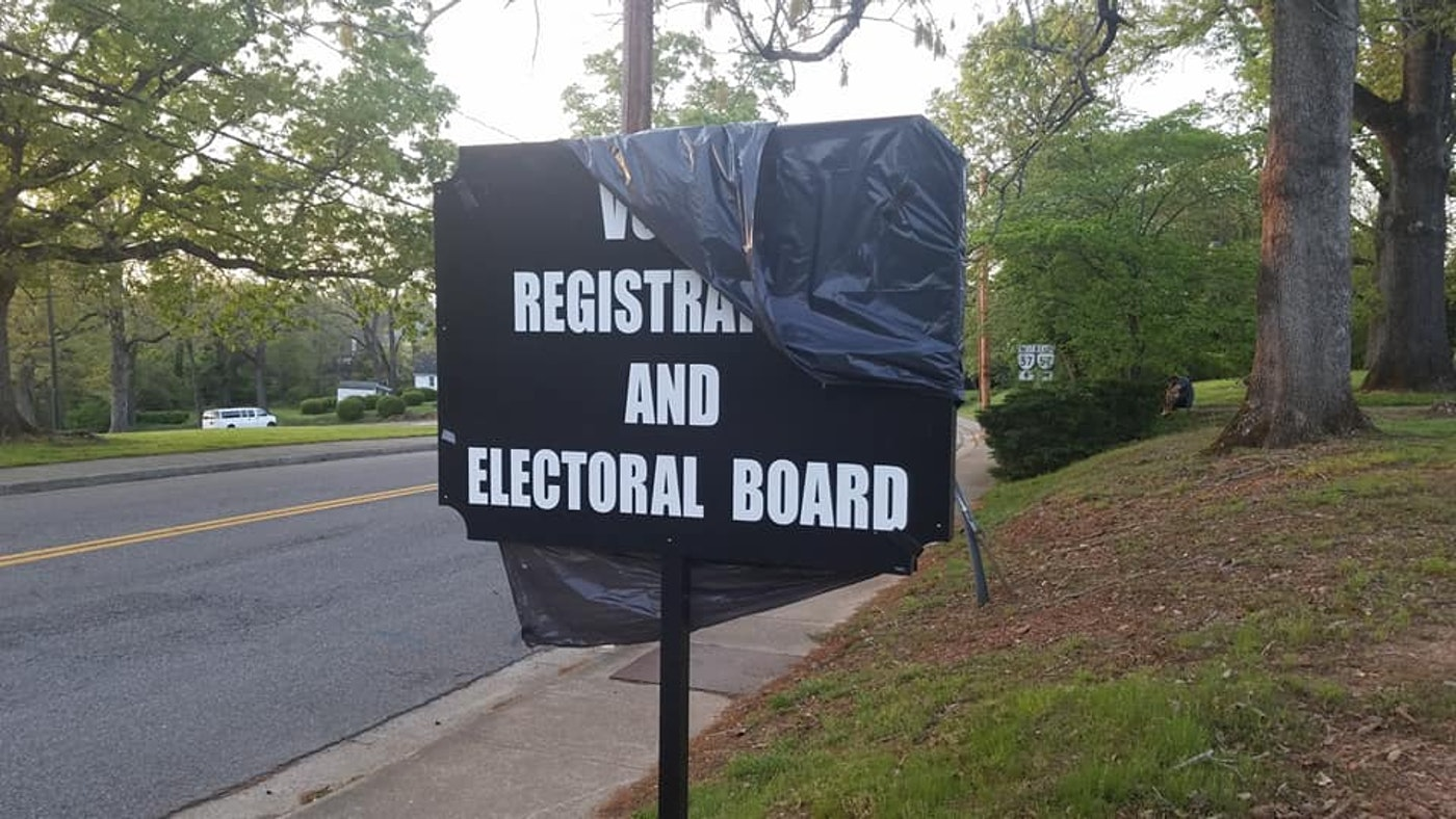 A garbage bag partially covers the sign denoting the former registrar's office in Chatham.