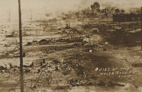 FILE - This photo provided by the Department of Special Collections, McFarlin Library, The University of Tulsa shows the ruins of Dunbar Elementary School and the Masonic Hall in the aftermath of the June 1, 1921, Tulsa Race Massacre in Tulsa, Okla. (Department of Special Collections, McFarlin Library, The University of Tulsa via AP, File)