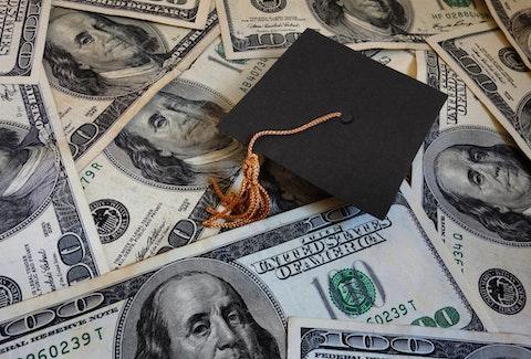 Graduation cap on money
