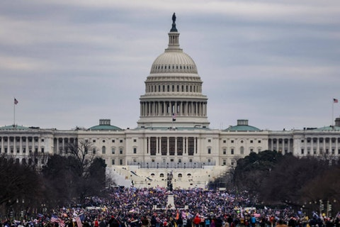 Supporters of President Donald Trump surround the U.S. Capitol following a rally on January 6, 2021 in Washington, DC. Trump supporters gathered in the nation's capital today to protest the ratification of President-elect Joe Biden's Electoral College victory over President Trump in the 2020 election. (Photo by Samuel Corum/Getty Images)