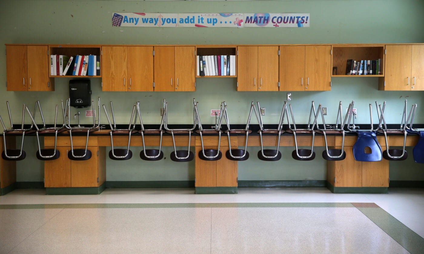 A finished clean room with stacked chairs in the science room at the Mildred Avenue K-8 School building in Boston's Mattapan, which were being cleaned for the reopening of school on July 9, 2020. Photo by David L. Ryan/The Boston Globe via Getty Images)