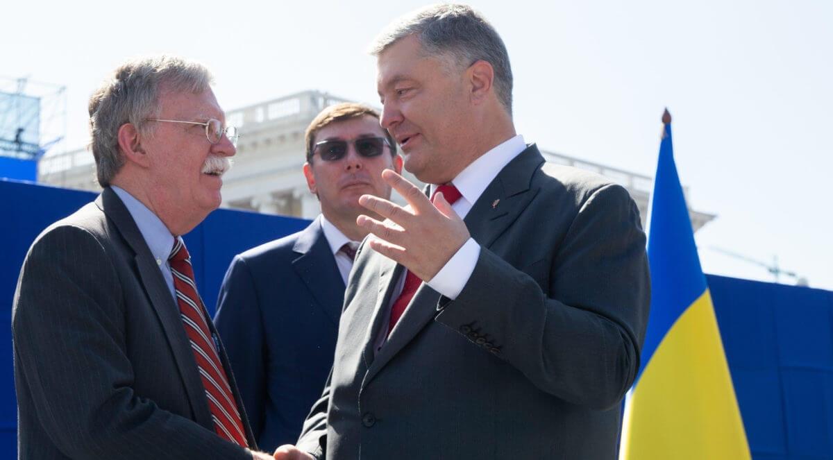 Former National Security Advisor John Bolton with Ukraine officials in 2018. Image via Shutterstock.
