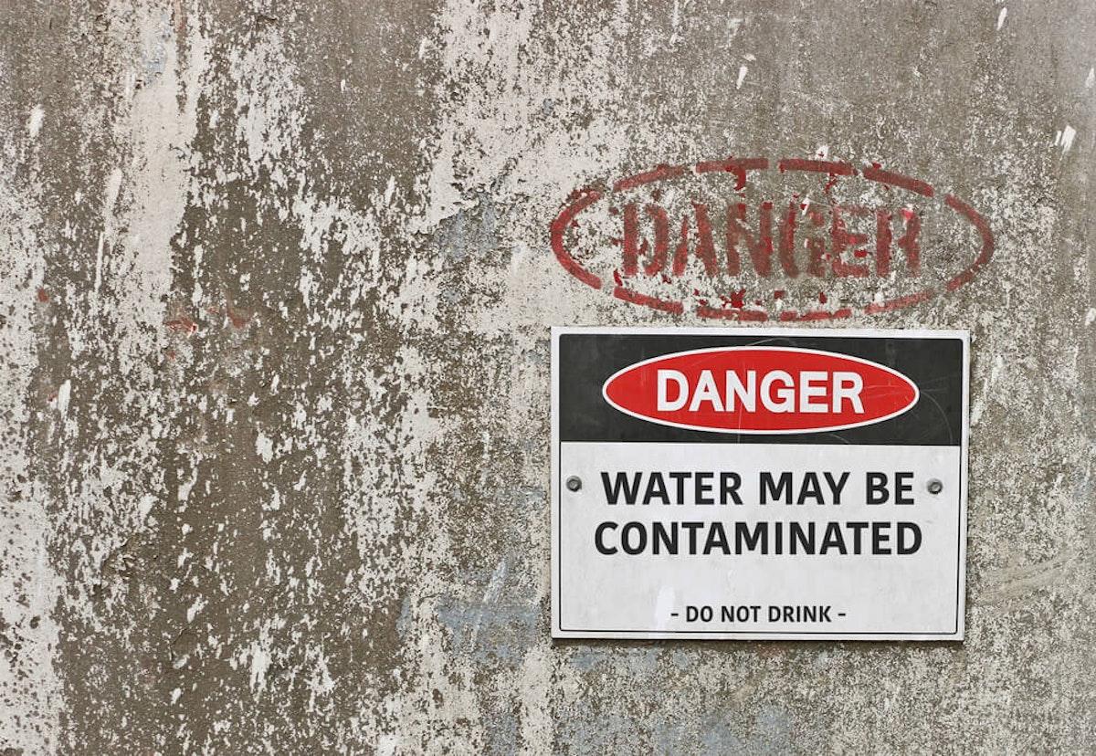 Sign warning of contaminated water