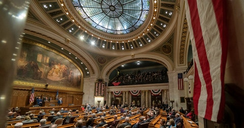 State lawmakers gathered on the Assembly floor. (Photo © Andy Manis)