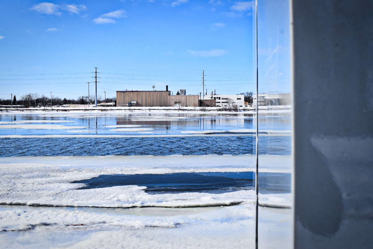 """The Fox River is reflected in the """"River Monolith"""" sculpture along Green Bay's riverfront. (Photo by Jonathon Sadowski)"""