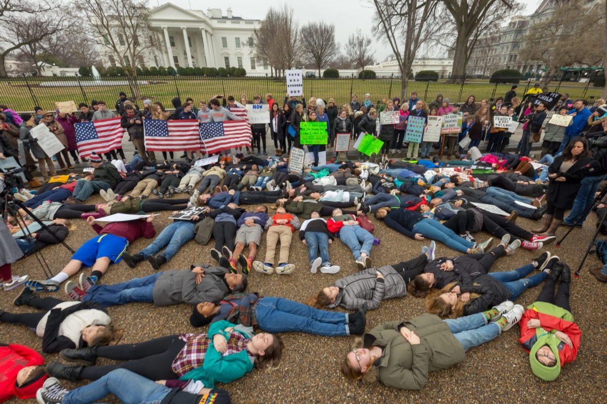 "High school students stage a ""lie-in"" in front of the White House in 2018 