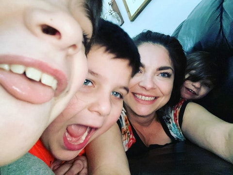 Erica Carulli poses for a fun selfie with her sons Dominick, 9, Anthony, 5, and Luca, 3.