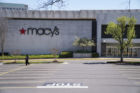The Macy's store at the popular Tyson's Corner Center sits closed Monday, March 30, 2020, in McLean, Va., a Washington, D.C., suburb. (AP Photo/J. Scott Applewhite)