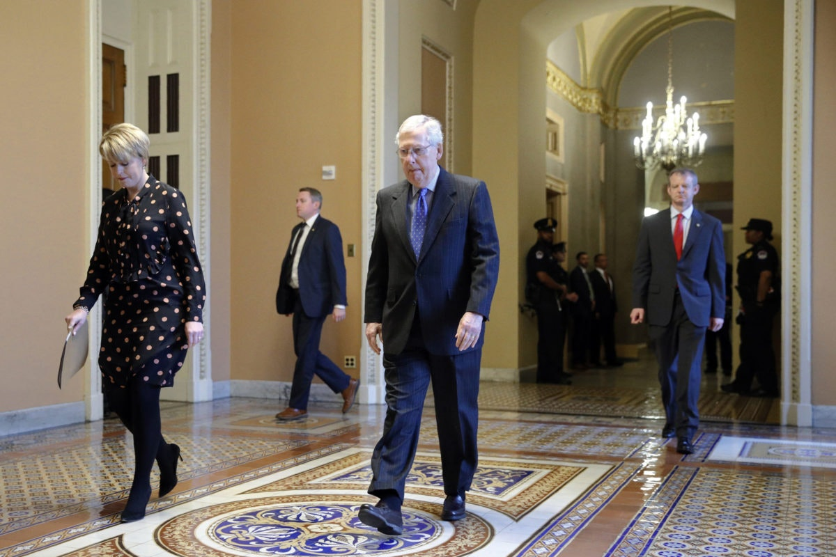 Senate Majority Leader Mitch McConnell of Ky. walks to the Senate chamber on Capitol Hill in Washington, Tuesday, March 24, 2020. (AP Photo/Patrick Semansky)