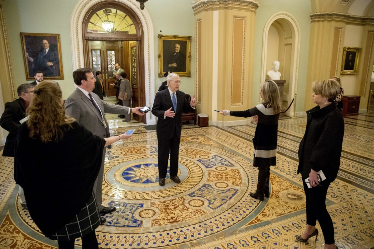 Senate Majority Leader Mitch McConnell practices social distancing. AP Photo/Andrew Harnik