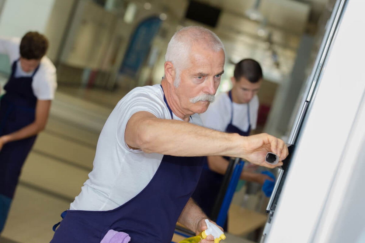 Man cleaning school coronavirus